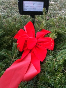 Christmas wreath on a new grave at Arlington National Cemetery.